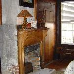 fireplace in the bedroom of the Queen Suite