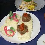 Mini kobe burgers and corn cobs with aioli and cheese