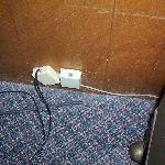 2 phone plugs, neither worked, mystery frayed wire coming out of floor