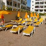 The sunbeds near the pool