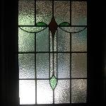 The moring sun greets us through a stainglass window facing East