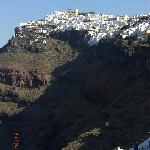 Looking back at Imerovigli from Fira. Mero Vigla is just below the blue dome at the top of the h