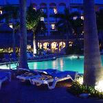 the swimming pool and the hotel at night