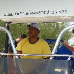 Peter at the helm of his boat