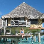 My wife on the overwater dock to our room