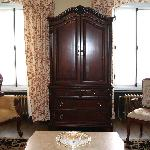 Armoire and chairs in suite sitting room