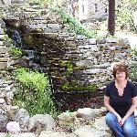 Judy at the Benton Place water fall and pond....