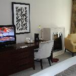 credenza and fireplace in king deluxe room