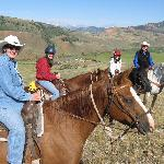 Family riding fun in the hills above the ranch - Grand Tetons in the background and ranch spreab