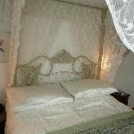 lace, lace and more lace!  Four poster bed in room.