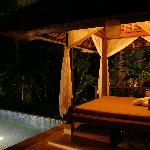 View of the pool and day bed at night