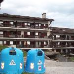 Apartments, parking lot and recycle containers