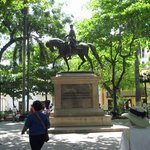 A statue of Simon Bolivar in the plaza.