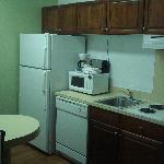 Kitchen area. Fridge, stove, and microwave. Impressive.