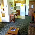 Looking toward kitchen area and entry door