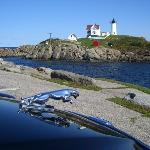Snapping a photo of my car and the nearby lighthouse