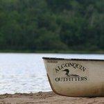 On the beach, rental canoe.