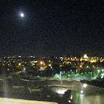 full moon over the city from the lounge deck