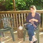 My wife knitting on basement deck