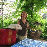Helen serving breakfast