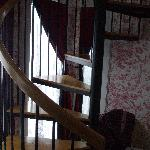 """Spiral staircase leading to sitting area in the """"Turrett Room"""""""