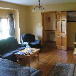 Living room of type D single cottage taken from kitchen doorway