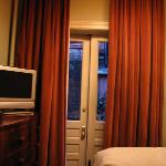 Dusty Rose velour curtains leads out to...