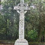 The celtic cross at a grave in the grounds