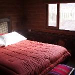 The bedroom.  The bathroom is to the back left.  There was a heater, and a decorative half of a