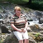 Me on the river rocks behind hotel