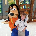 Goofy hugging one of the Kids