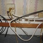 electric cords by baseboard heater at Bennington Motor Inn