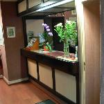 Front desk, note the fresh flowers, up-dated flooring