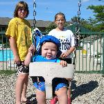 Kids enjoying the playground by the pool