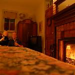Enjoying a glass of wine in front of our fireplace