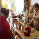 Cider being rung up on the register at Gross' Orchard.  The red bottle is cherry apple cider.