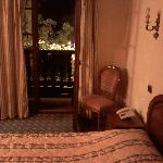 Bed and door leading to balcony