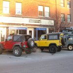 expedition vehicles parked in front of the inn