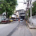 The street market next to the hotel with the BTS Skytrain station Thong Lo at the end of the str