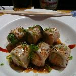 Snow crab meat and avocado wrapped in butterfish torched with garlic-soy