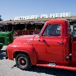 Ford F-100 parked outside the fruit stand.