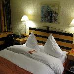 Large bed, but soft matress. Funny set up of pilllows. Daily fresh fruit ! Bathroom has glass  f
