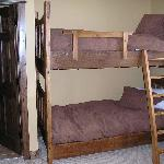 Bunk beds in a room that also has a double bed and ensuite.