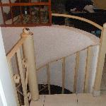 Spiral staircase from bathroom door