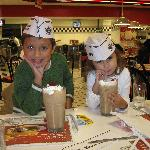 Kids drinking malts in dining room at Steak 'N Shake in NW Houston