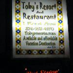 The Toby's sign with the Red Stripe sign in the background