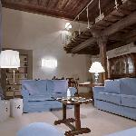 We stayed in the Caravaggio apartment in July.This is a photo of the living room (taken on arriv
