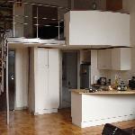 Loft Aparment facing kitchen, front door, bathroom and bedroom