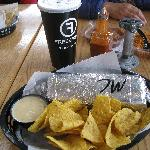 Monster size burrito revved up with chips & queso at Freebirds