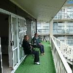 friends on the veranda outside the units
